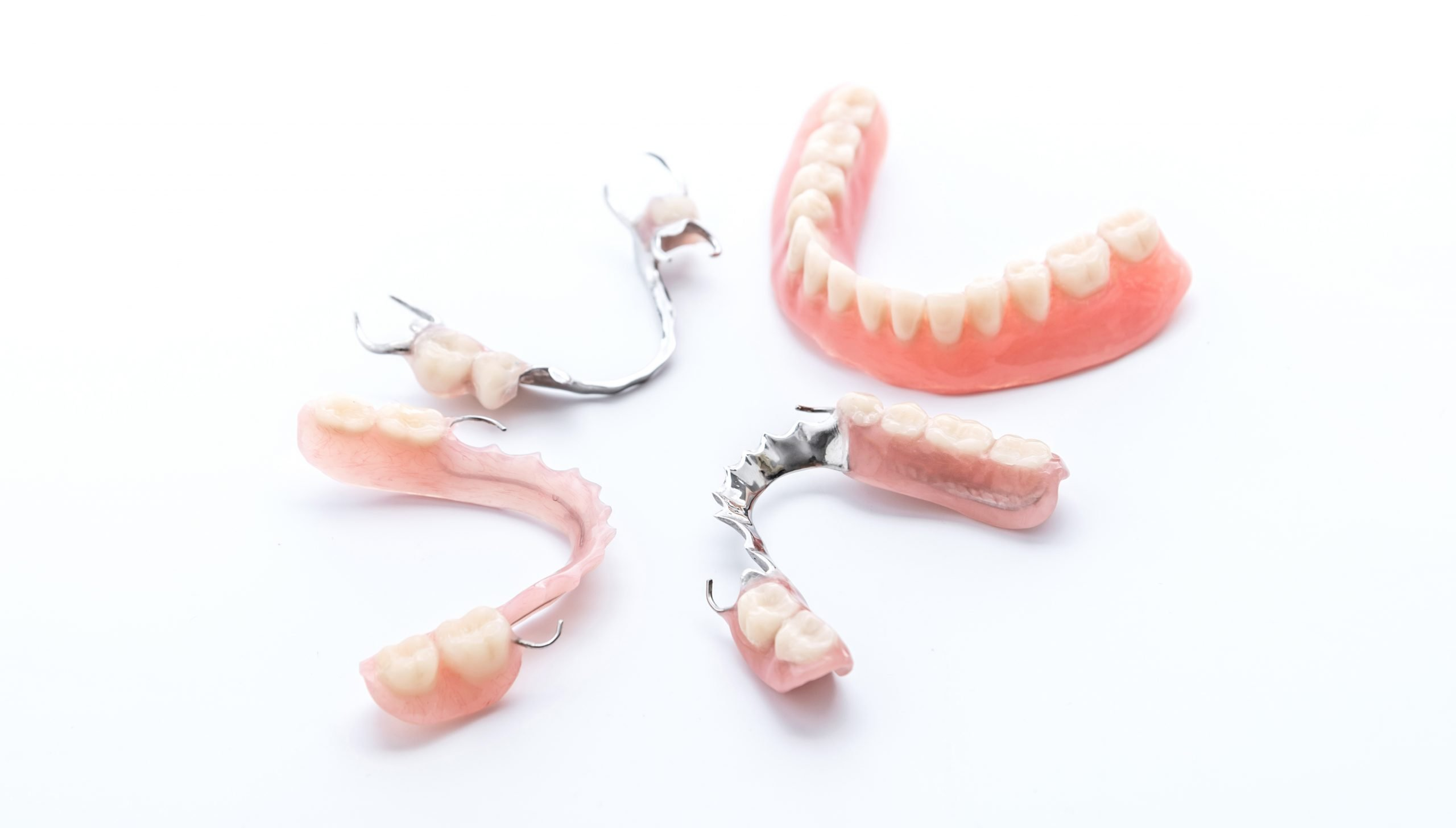 Parts of dentures on white background